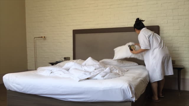 time lapse: woman making bed clean and tidy - messy stock videos and b-roll footage