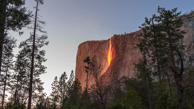 4k time lapse yosemite national park with the horsetail waterfall creating the fire fall effect at sunset - yosemite national park stock videos & royalty-free footage