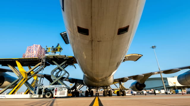 time lapse zoom in loading cargo outside cargo plane - shipping stock videos & royalty-free footage