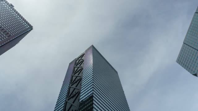 4k time lapse zoom in office building and sky - sunny stock videos & royalty-free footage