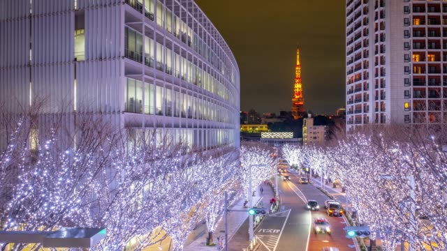 4k time lapse - zoom in roppongi area with light decoration on the tree with tokyo tower iconic landmark of tokyo in background - roppongi tokyo japan - roppongi stock videos and b-roll footage