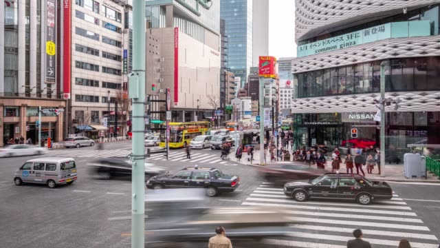 4k time lapse - zoom in traffic car transportation at intersection with pedestrian crossing the street - ginza tokyo japan - editorial stock videos & royalty-free footage