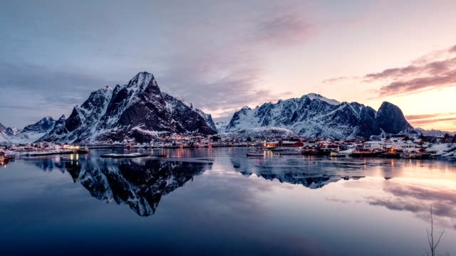 time lapse zoom of norwegian fishing village surrounded with mountains in morning - dusk stock videos & royalty-free footage