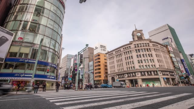 4k time lapse - zoom out pedestrian crossing zebra crossing with traffic light and car transportation - ginza tokyo japan - ginza stock videos & royalty-free footage