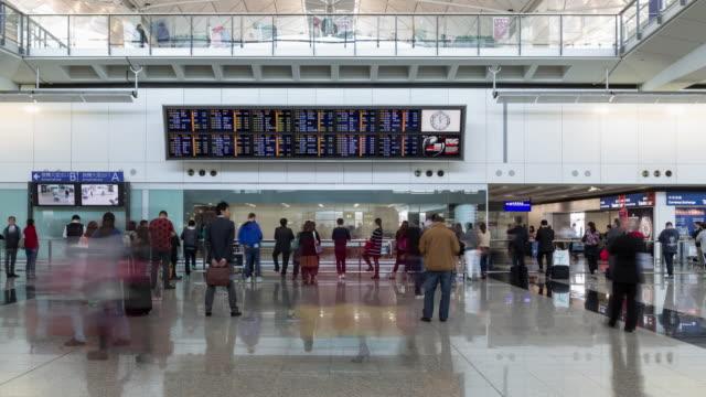 time lapse/4k/airport interior / hong kong, china - hong kong international airport stock videos & royalty-free footage