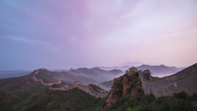 time lapse-awe sunrise of jinshanling great wall - great wall of china stock videos & royalty-free footage