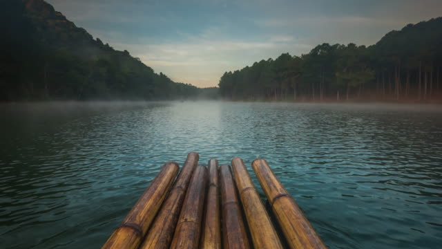 time lapse,bamboo rafting on the lake - bamboo plant stock videos and b-roll footage