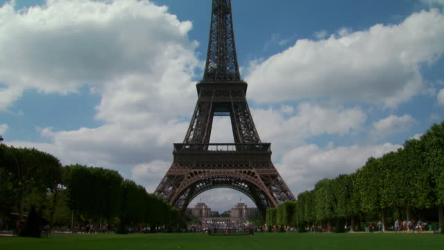 time lapsed lower view of the eiffel tower - unknown gender stock videos and b-roll footage