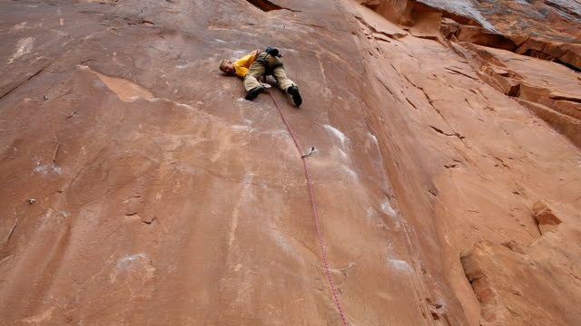 Time lapsed upward view of a rock climber falling