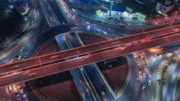 Time lapse,Hyper lapse ,Of traffic on city streets at night. Aerial view and top view of traffic on freeway, 4K.
