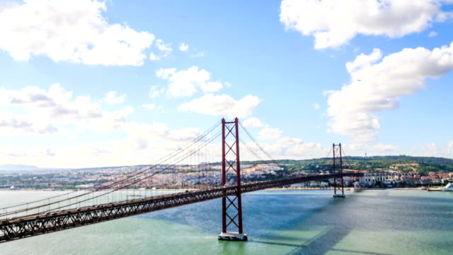 time lapse:lisbon bridge - april 25th, old salazar bridge, portugal - lisbon stock videos and b-roll footage