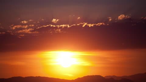 time lapse-orange sunset - sunset stock videos & royalty-free footage