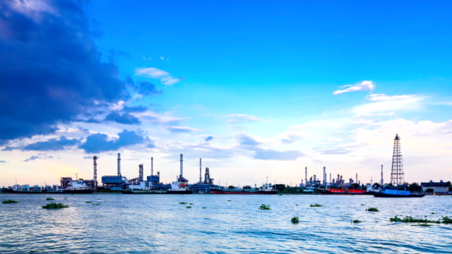 HD time lapse,petrochemical oil refinery plant along a river