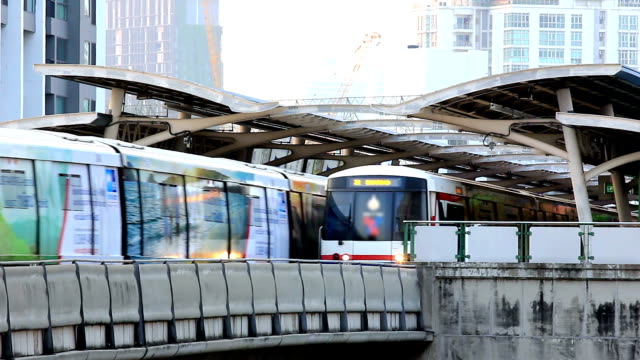 hd time lapse,rush hour sky train in big city - elevated train stock videos and b-roll footage
