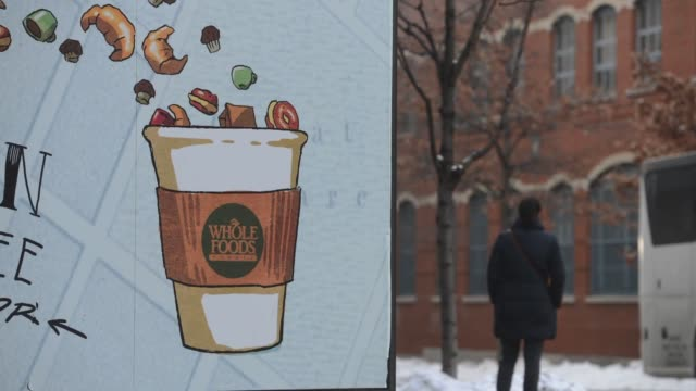 time lapses of a whole foods location in tribeca new york ny us on monday february 10 wide shot pan of pedestrians walking by store front with whole... - whole foods market stock videos and b-roll footage