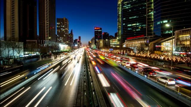 time lapse-urban highway traffic at night in beijing cbd - tail light stock videos & royalty-free footage