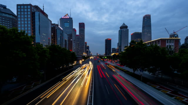 time lapse-urban highway traffic day to night - light trail stock videos & royalty-free footage