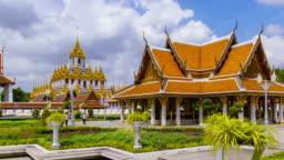 Time Lpase: Loha Prasat, golden metal multi-top or spires castle monastery, Wat Rajanaddaram Temple,and Royal Pavilion, Bangkok old town, Thailand; pan right