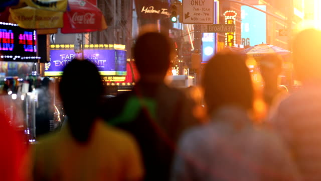 time square crowds at sunset - population explosion stock videos and b-roll footage