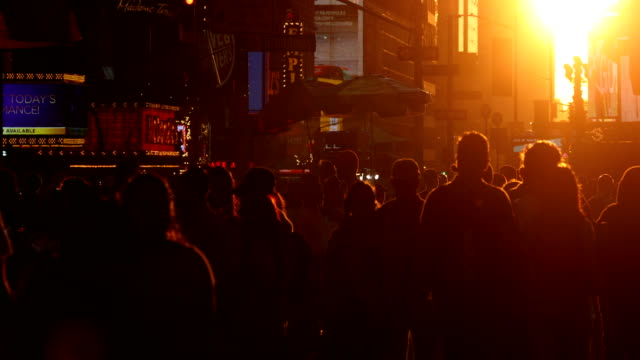 time square crowds at sunset - international landmark stock videos & royalty-free footage