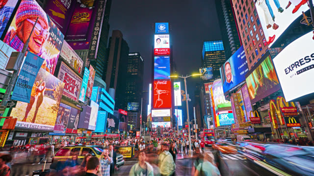 time square. landmark. grand view. people. traffic. yellow taxi. illumination. advertise - advertisement stock videos & royalty-free footage