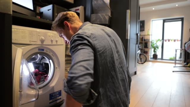 time to do the washing - modern manhood stock videos & royalty-free footage