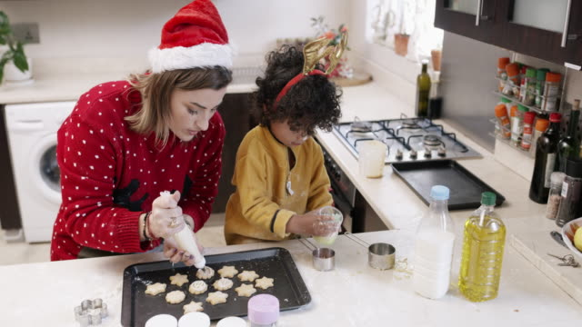 time to make these cookies look more festive - decorating stock videos & royalty-free footage
