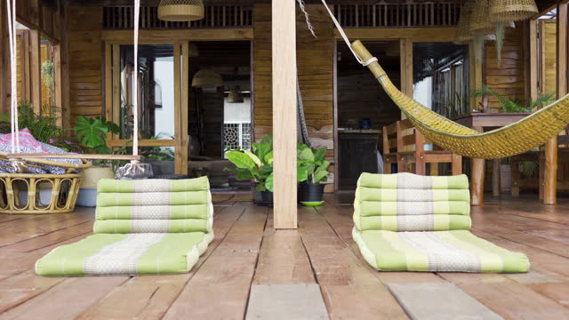 time to relax two thai cushions on villa wooden deck - side by side stock videos & royalty-free footage