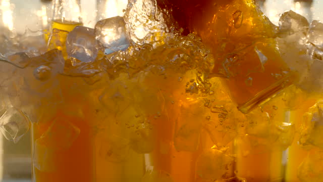 super slo mo time warp shot of a hand is taking a bottle of cold drink from a cooler - dusk stock videos & royalty-free footage