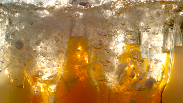 super slo mo time warp shot of refiling a cooler with ice cubes - cooler container stock videos & royalty-free footage