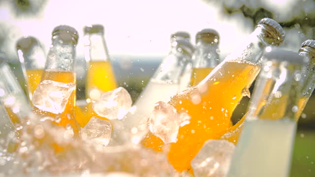 super slo mo time warp shot of throwing ice over bottles in a cooler - cooler container stock videos & royalty-free footage