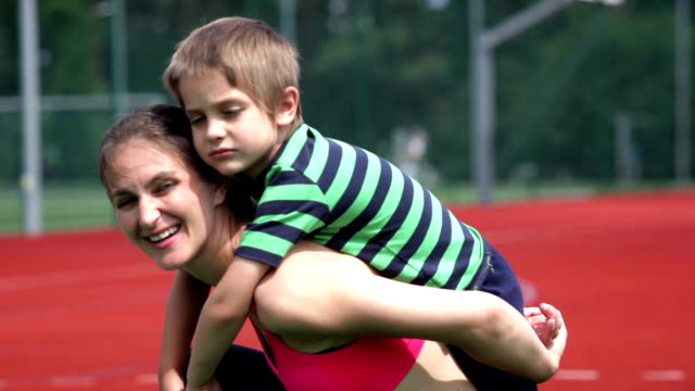 time with mum on tennis court - piggyback stock videos and b-roll footage