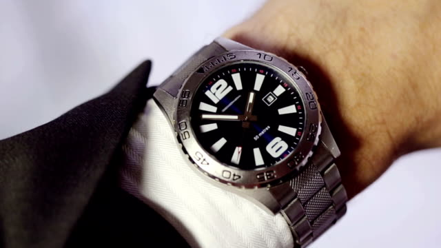 time wristwatch - checking the time stock videos & royalty-free footage