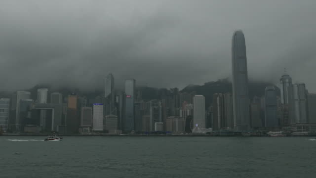 Timelape city in smoke and darkness by foggy day at Hong Kong, China,Tilt up.