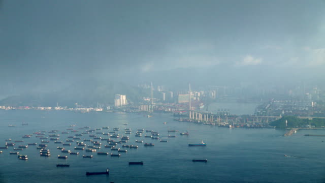 Timelape city in smoke and darkness by foggy day / Hong Kong, China