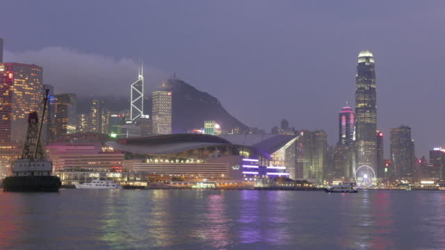 timelape city in smoke and darkness by foggy day / hong kong, china - establishing shot stock videos & royalty-free footage