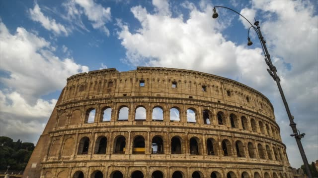 timelapes : colosseum at dusk, rome, italy - colosseo video stock e b–roll