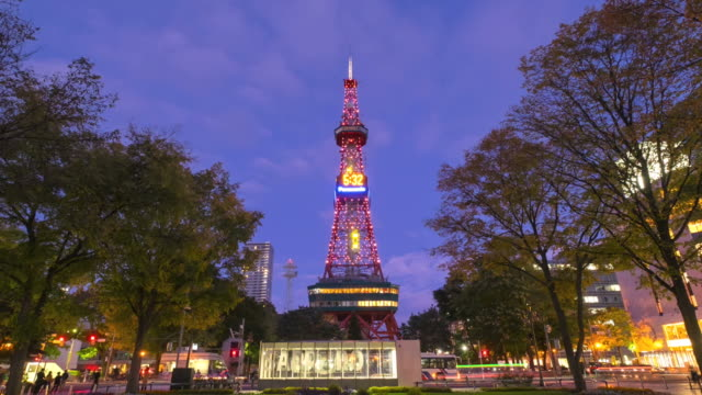 HD Timelapes : Sapporo tower in odori park at twilight