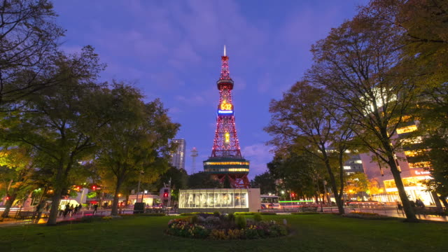 hd timelapes : sapporo tower in odori park at twilight - hokkaido stock videos & royalty-free footage