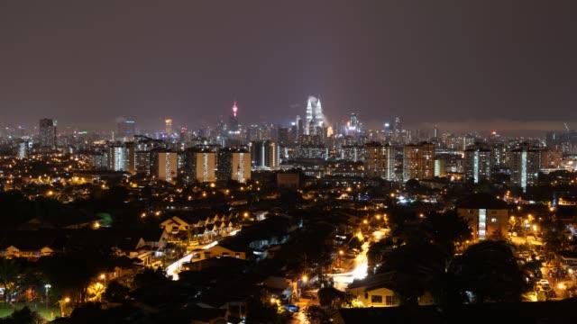 timelaps of neon lights in downtown kuala lumpur, malaysia - menara kuala lumpur tower stock videos & royalty-free footage