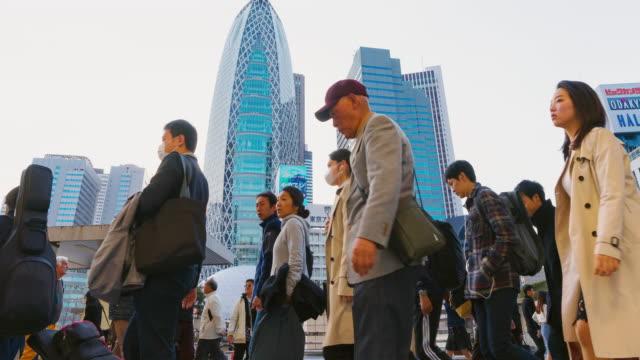 vídeos y material grabado en eventos de stock de t/l ws zo time-lapse: 4k viajar diariamente en la gran ciudad con multitud de personas en shinjuku, tokio, japa - 10 seconds or greater