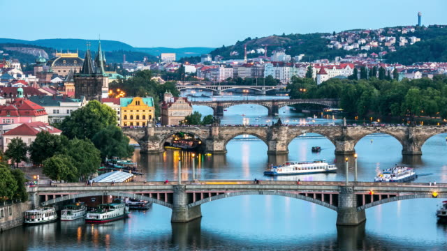 4k time-lapse: aerial bridges on vltava, prague dusk czech republic - river vltava stock videos & royalty-free footage
