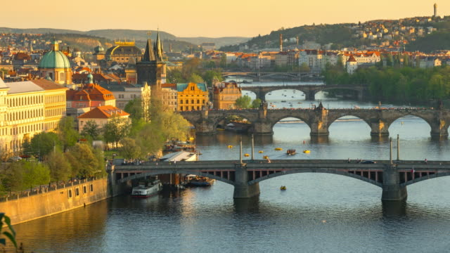 time-lapse: aerial bridges on vltava river, prague czech republic - ponte video stock e b–roll