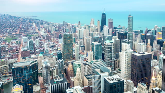 hd time-lapse: aerial chicago skyline cityscape at dusk usa - chicago loop stock videos and b-roll footage
