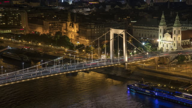 timelapse aerial high angle view of part of suspension history bridge and city in budapest, hungary, elisabeth bridge at night. many transportations such as car, bus, nautical vessel, tour boat along the danube river. concept of travel destination. - vessel part stock videos & royalty-free footage