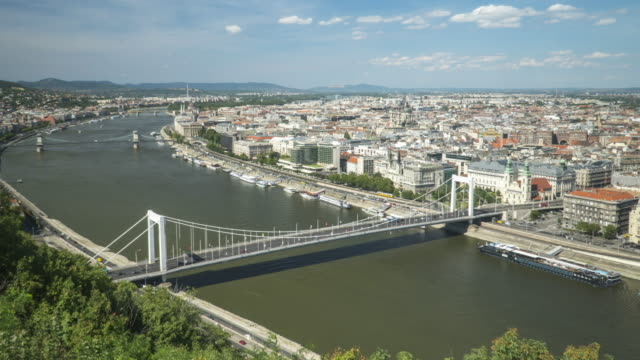 timelapse aerial high angle view of suspension history bridge in budapest, hungary, elisabeth bridge, and szechenyi chain bridge. many transportations, car, bus, nautical vessels along the danube river. concept of travel destination with urban skyline. - chain bridge suspension bridge stock videos & royalty-free footage