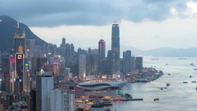 Time-lapse: Aerial Hong Kong Skyline Cityscape at dusk, tilt down Video.