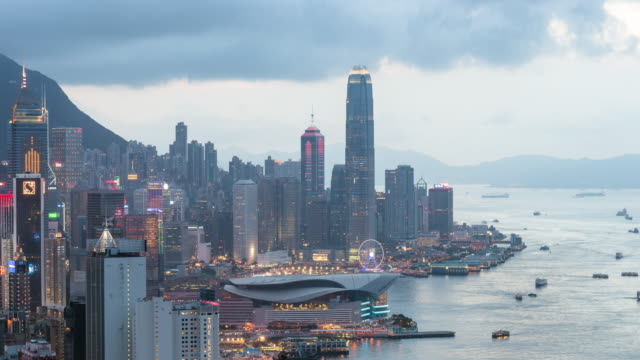 time-lapse: aerial hong kong skyline cityscape at dusk,zoom in video. - economy stock videos & royalty-free footage