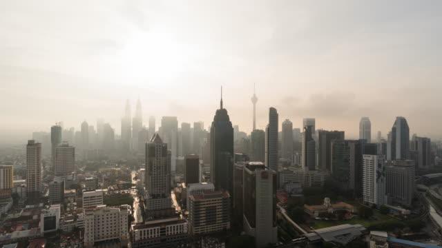 4K Time-Lapse: Aerial Kuala Lumpur Cityscape,tilt down.