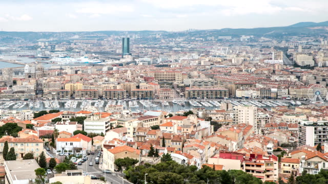hd time-lapse: aerial marseille city with old vieux port - notre dame de la garde marseille stock videos and b-roll footage